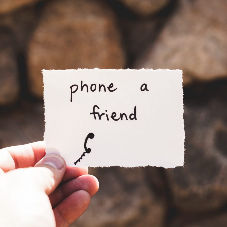 A helpful post-it note reminding you to phone a friend when you are feeling anxious and isolated.