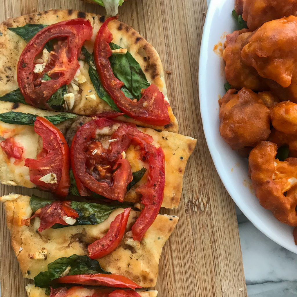 Enjoy a tech free date night at home with fun games and food like garlic, tomato, and spinach flatbread.