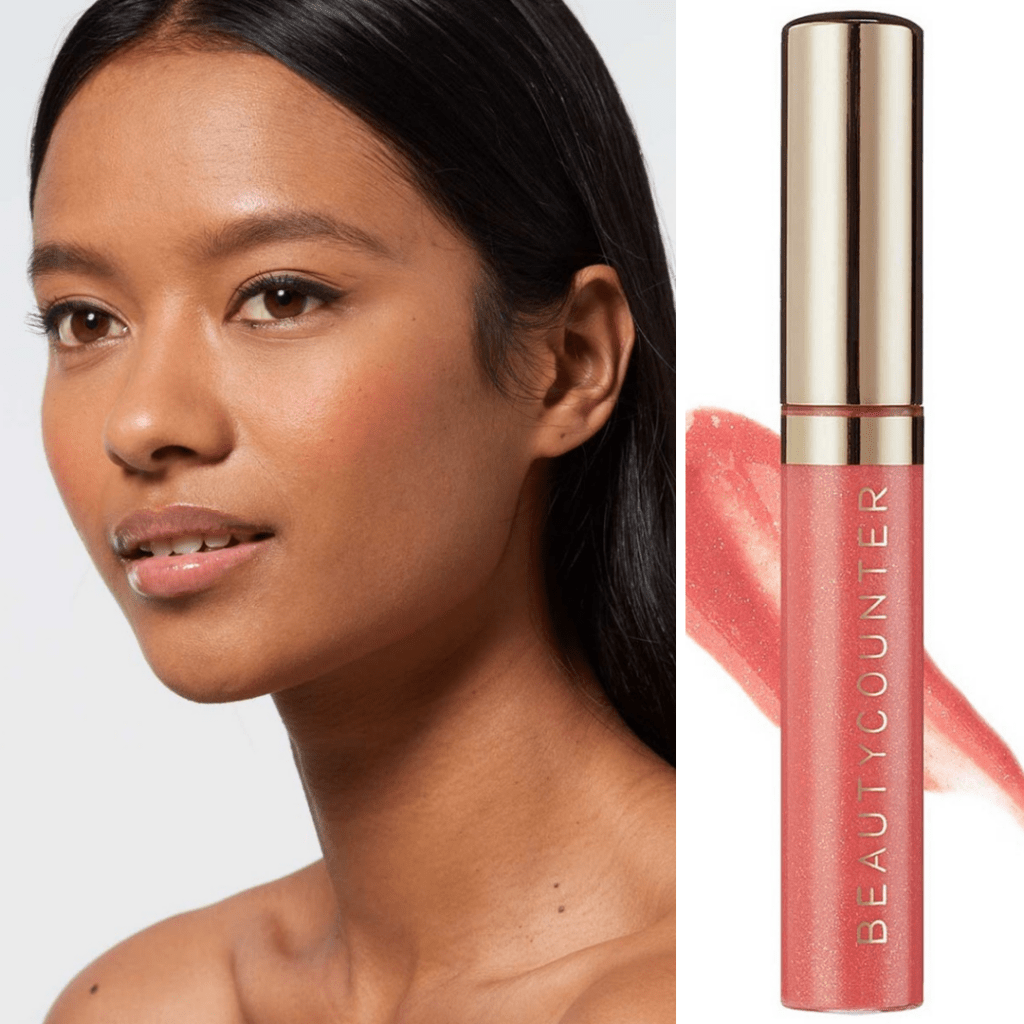 Brown skinned model wearing beauty counter lip gloss in the shade blush shimmer